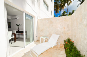 outdoor patio with chaise lounge chair in ground floor condo at The SANCTUARY at Los Corales