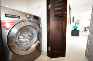 laundry room in ground floor condo at The SANCTUARY at Los Corales