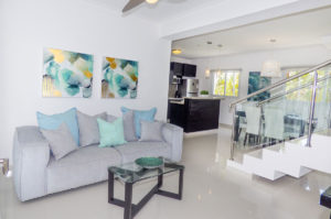 living room with view of kitchen and stairs in penthouse condo at The SANCTUARY at Los Corales