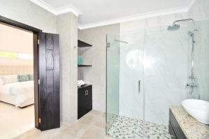 bathroom with standing shower attached to bedroom in penthouse condo at The SANCTUARY at Los Corales
