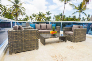 balcony with sofas, chairs and fruitbowl on a table at penthouse condo at The SANCTUARY at Los Corales