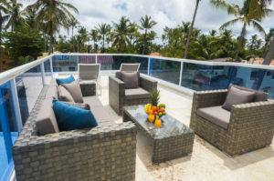 balcony with tables, chairs, table with fruit bowl in penthouse condo at The SANCTUARY at Los Corales