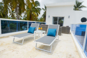 two lounge chairs with side table with drinks atop in penthouse condo at The SANCTUARY at Los Corales