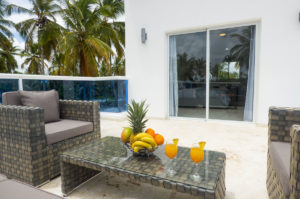balcony with two chairs and table with fruitbowl and drinks in penthouse condo at The SANCTUARY at Los Corales