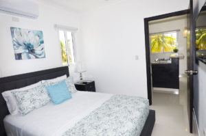 bedroom with view of kitchen in penthouse condo at The SANCTUARY at Los Corales