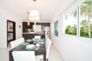 dining room and kitchen in penthouse condo at The SANCTUARY at Los Corales