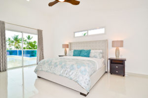 large bedroom with balcony in penthouse condo at The SANCTUARY at Los Corales