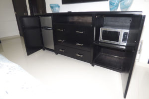 bedroom dresser with mini fridge and microwave in penthouse condo at The SANCTUARY at Los Corales