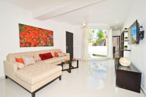 living room with large window in second floor condo at The SANCTUARY at Los Corales