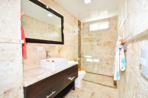 bathroom with standing shower in second floor condo at The SANCTUARY at Los Corales