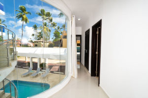 large window with pool view in hallway of second floor condo at The SANCTUARY at Los Corales