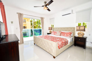 bedroom with balcony in second floor condo at The SANCTUARY at Los Corales