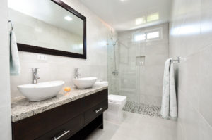 bathroom with standing shower and double sinks in penthouse condo at The SANCTUARY at Los Corales