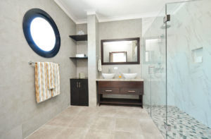 large bathroom with double sinks and standing shower in penthouse condo at The SANCTUARY at Los Corales