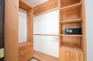 built in closet with safe in a penthouse condo at The SANCTUARY at Los Corales