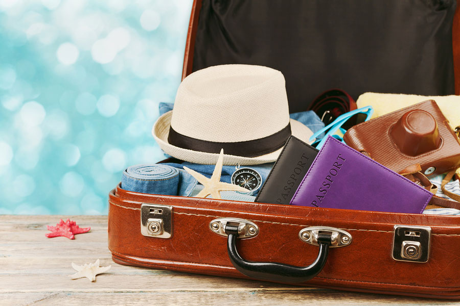 Packed vintage suitcase for summer holidays, vacation, travel and trip concept