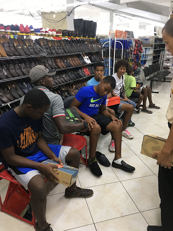 group of boys shopping for shoes