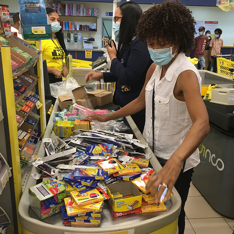 woman sorting through donated supplies