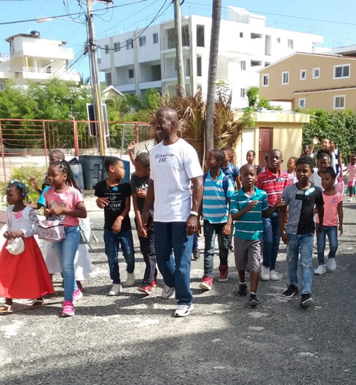 """Children on their way to The SANCTUARY for """"Back-to-School Rally and Beach Party"""""""
