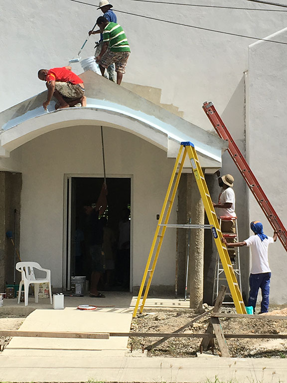 Painting a church in El Seibo