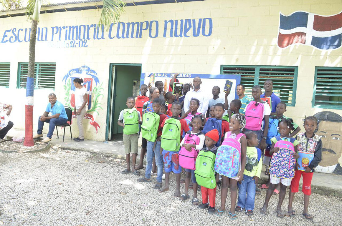 New backpacks and school supplies for children in sugarcane community